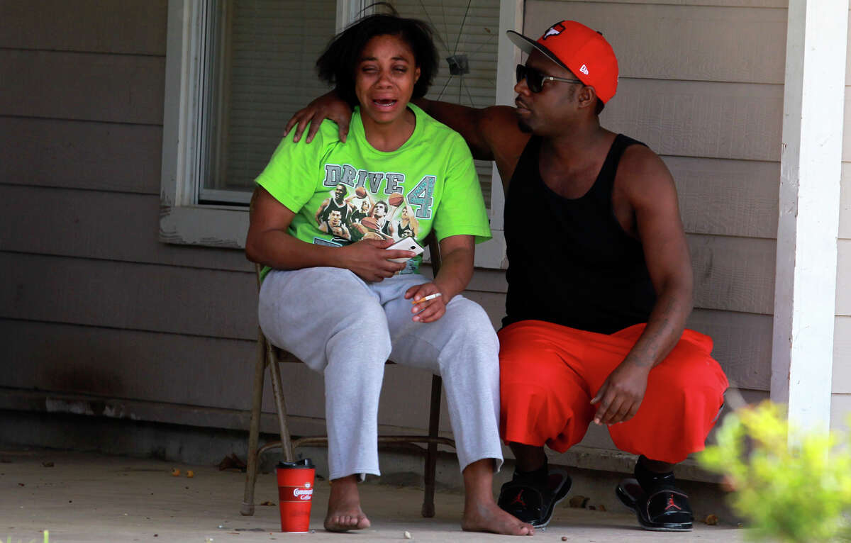 A man consoles a woman Friday April 18, 2014 at a home on the 800 block of Sterling Drive after seven-year-old Kashion Johnson went missing about 1:30 a.m. Friday. Moments later a family friend who lived several blocks away arrived with the missing child. When the mother was reunited with the child she became belligerent and was detained by police.