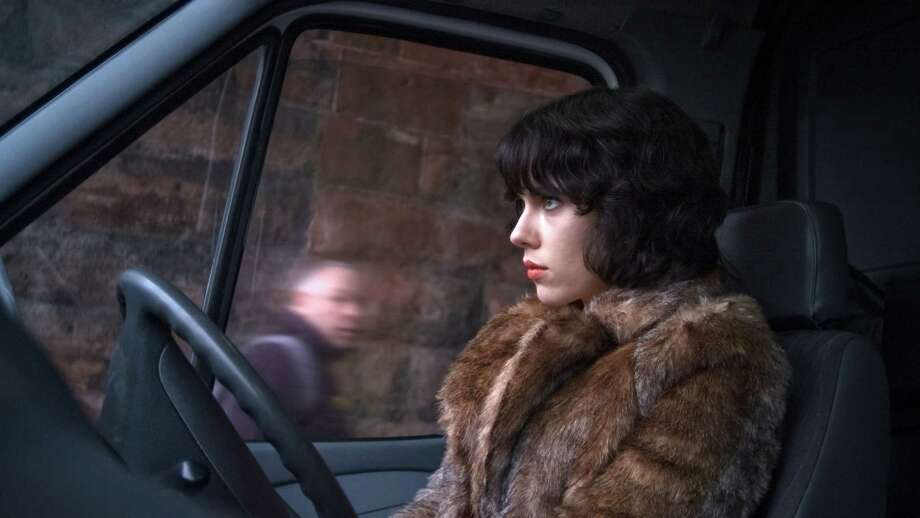 "This image released by A24 Films shows Scarlett Johansson in a scene from ""Under the Skin."" Sandwiched between the swaggering spectacle of summer and the chest-thumping ambition of awards season, spring moviegoing is usually an afterthought, a limbo for films not bankable enough for July or sufficiently arty-seeming for Oscar. But this season, the movies are alive. (AP Photo/A24 Films) ORG XMIT: NYET445 / A24 Films"