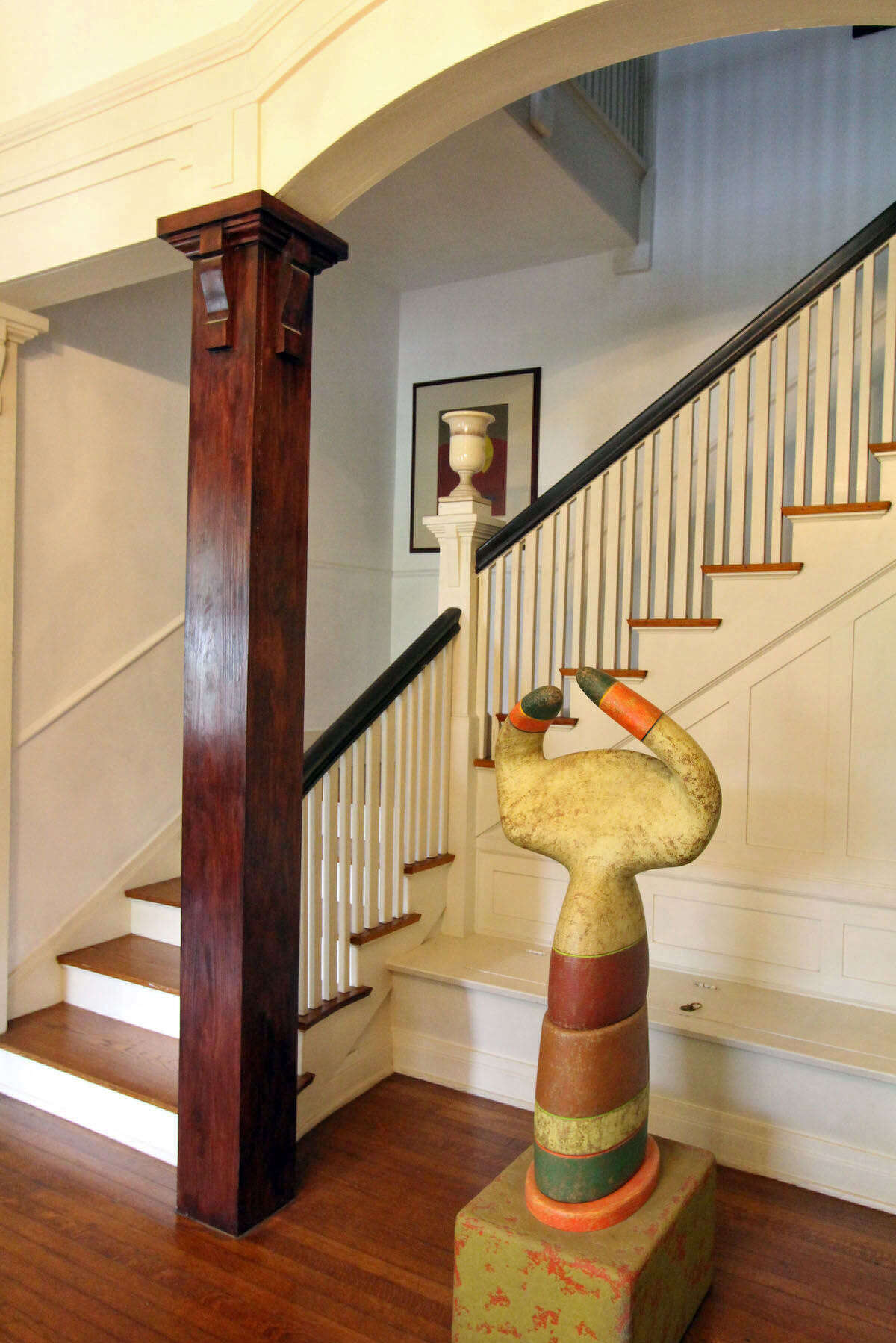 A statue by Beacon Hill artist Danville Chadbourne is the focal point of the entry.