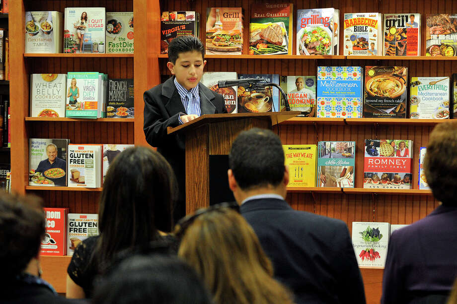 "Luis Guaillas reads from his winning essay ""My Favorite Teacher"" during the My Favorite Teacher Contest's Local Teacher of the Year Award ceremony honoring Turn of River Middle School teacher Miriam Gonzerelli at Barnes & Noble at Stamford Town Center in Stamford, Conn., on Wednesday, April 16, 2014. Photo: Jason Rearick / Stamford Advocate"