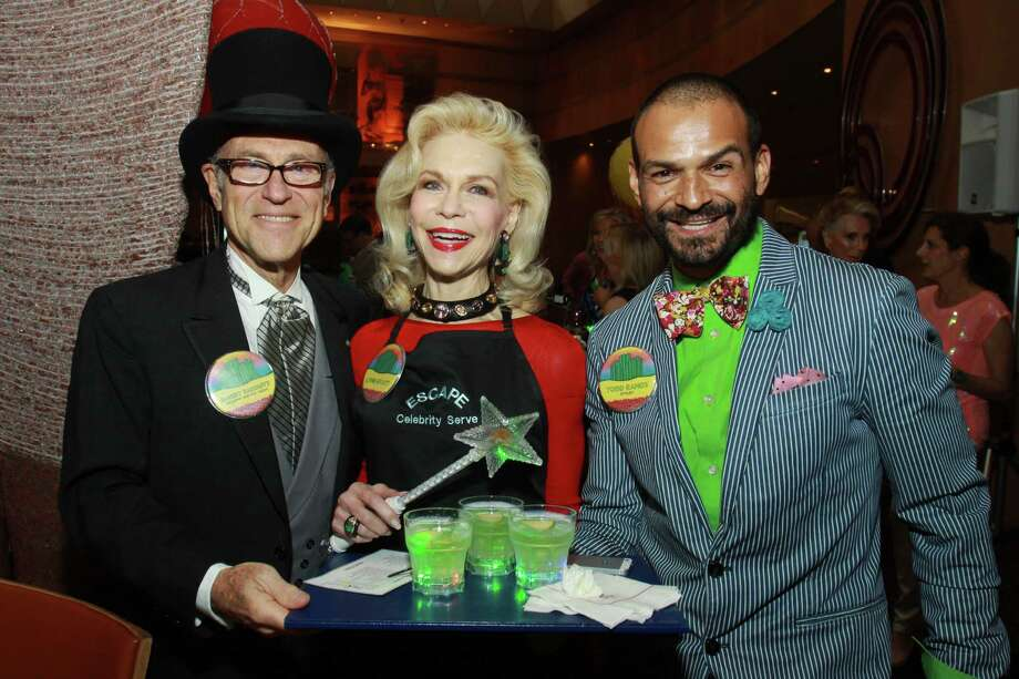 (For the Chronicle/Gary Fountain, April 13, 2014) Celebrity servers Robert Sakowitz, from left, Lynn Wyatt and Todd Ramos at the ESCAPE Celebrity Serve Benefit. Photo: Gary Fountain, Freelance / Copyright 2014 by Gary Fountain
