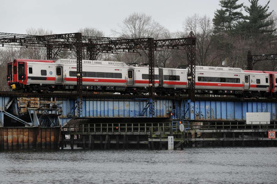 A Metro-North train crosses the Saugatuck River bridge, in Westport, Conn., Jan. 2, 2014. Photo: Ned Gerard / Connecticut Post
