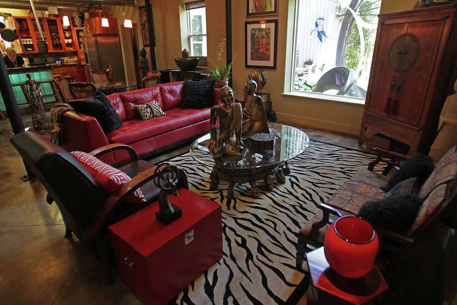 The living room in the home of artist Sharon Bartlett and her husband Dub Bartlett, the home is an unusual tin house that was built by her engineer husband Monday, April 7, 2014, in Houston. ( James Nielsen / Houston Chronicle ) Photo: James Nielsen, Staff / © 2014  Houston Chronicle