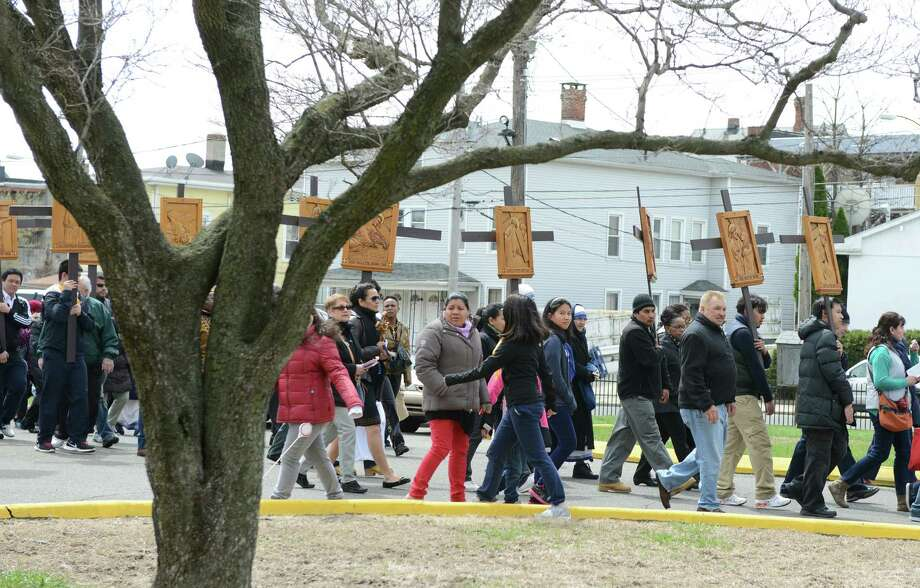 Parishioners and clergy take part in a Good Friday Passion of the Lord Multi-lingual Stations of the Cross Procession from St. Augustine Cathedral to St. Patrick Church Friday, April 18, 2014, in Bridgeport, Conn. Photo: Autumn Driscoll / Connecticut Post
