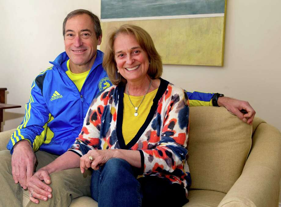 Robert and Avery Flowers pose for a photo in their Darien home on Friday, April 18, 2014. Robert ran the Boston Marathon for the first time in 2013 and plans to run again this year. Photo: Lindsay Perry / Stamford Advocate