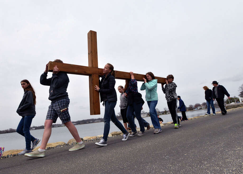The First Congregational Church of Greenwich Youth Cross Walk enters Greenwich Point, Good Friday afternoon, April 18, 2014. The cross was carried from the church in Old Greenwich to Greenwich Point, where it will be used for the sunrise service on Easter Sunday morning. Photo: Bob Luckey / Greenwich Time