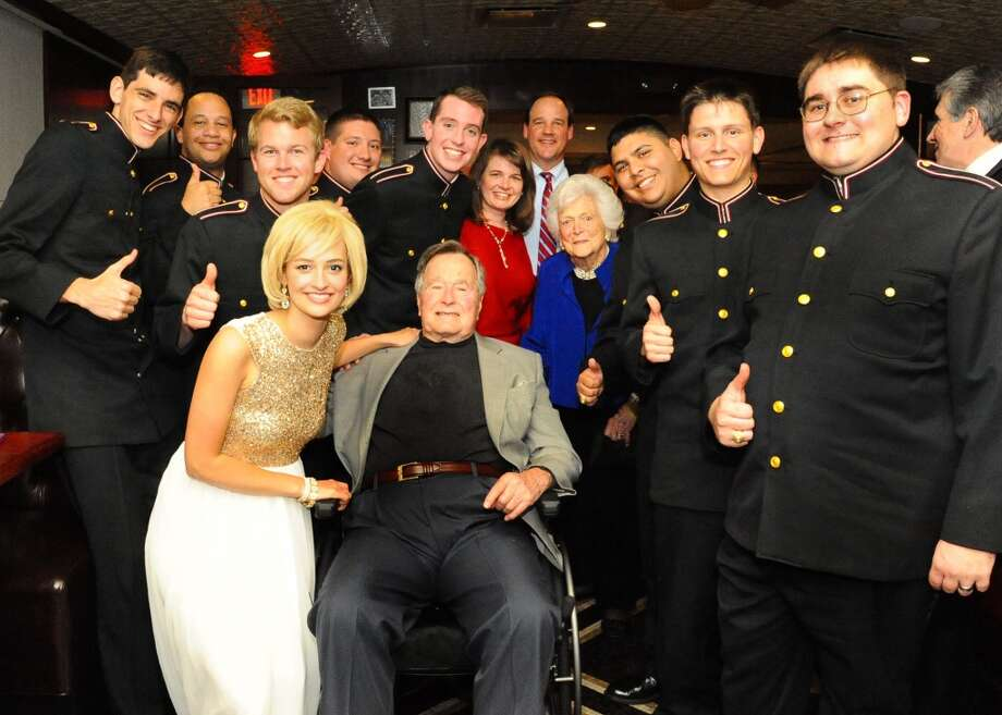 President George H. W. Bush at his pre-birthday bash poses with Marilyn Monroe impersonator, the Texas A&M Singing Cadets and his family and friends. Photo: Al Torres Photography