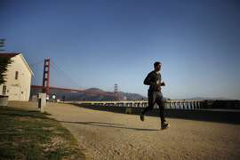 Ronnie Goodman runs at Crissy Field during a morning run on Friday, April 18, 2014,  in San Francisco, Calif.