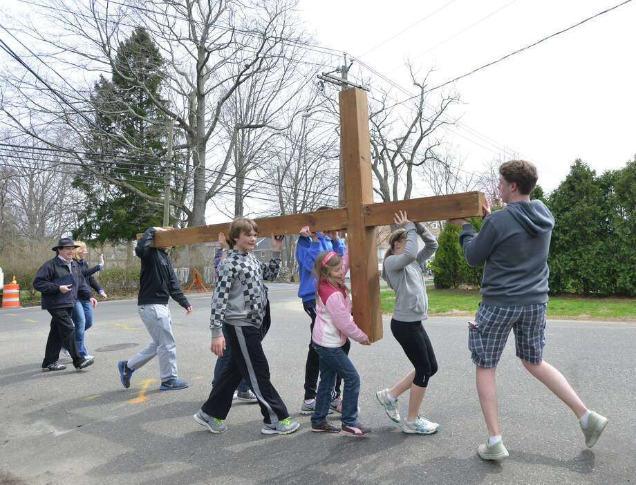 The First Congregational Church of Greenwich Youth Cross Walk in Old Greenwich, Conn., Good Friday afternoon, April 18, 2014. The cross was carried from the church in Old Greenwich to Greenwich Point, where it will be used for the sunrise service on Easter Sunday morning. Photo: Bob Luckey / Greenwich Time