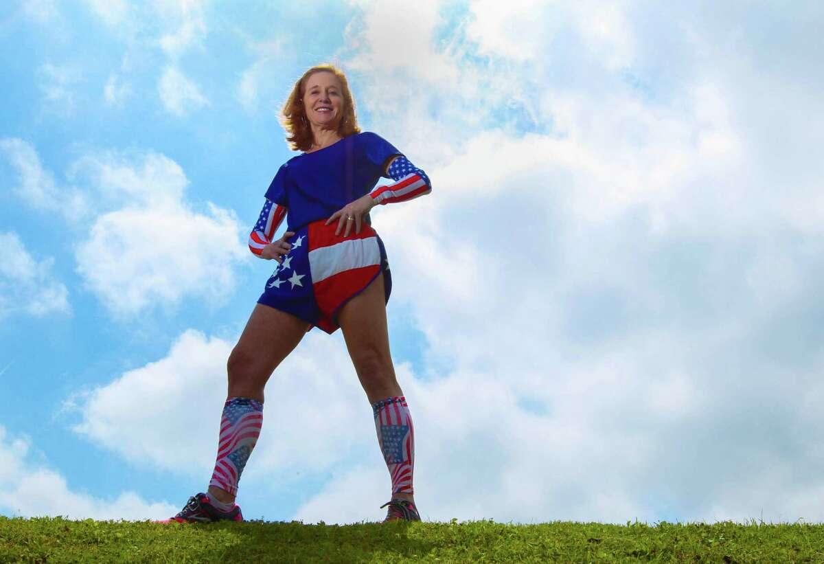University for Houston Professor Caryn Honig wearing her patriotic running gear Thursday April 17, 2014 at the University of Houston. Honig is running in