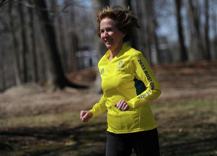 Mary Ellen Loncto goes for a run near her home in Ridgefield, Conn. Wednesday, April 16, 2014.  Loncto was just minutes from the finish line in last year's Boston Marathon when the explosions went off. Photo: Tyler Sizemore / The News-Times