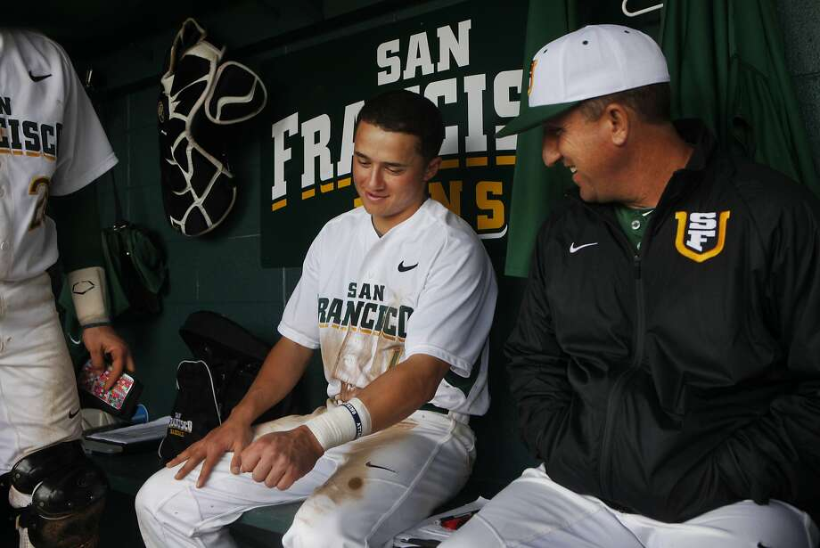 Nico (center) and Nino Giarratano are as close as a shortstop and head coach can be in the USF dugout. Photo: Leah Millis, The Chronicle
