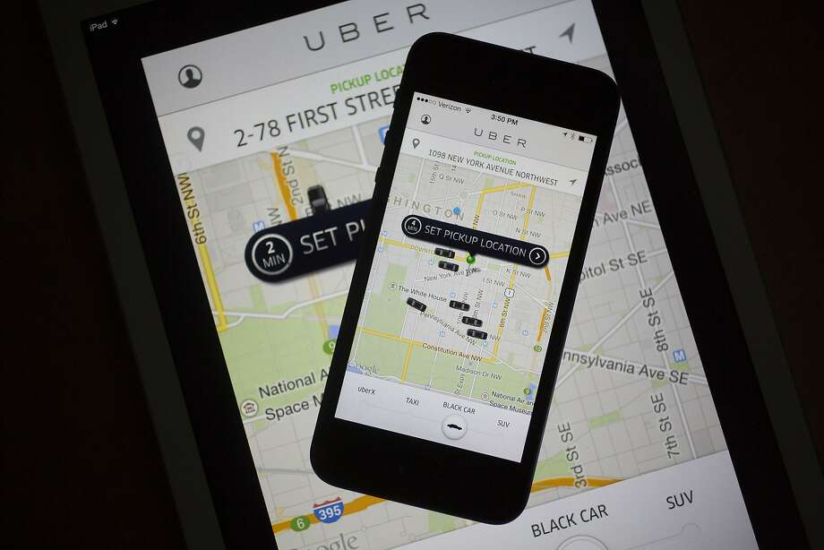 Uber customers can book rides through the smartphone app. Photo: Andrew Harrer, Bloomberg