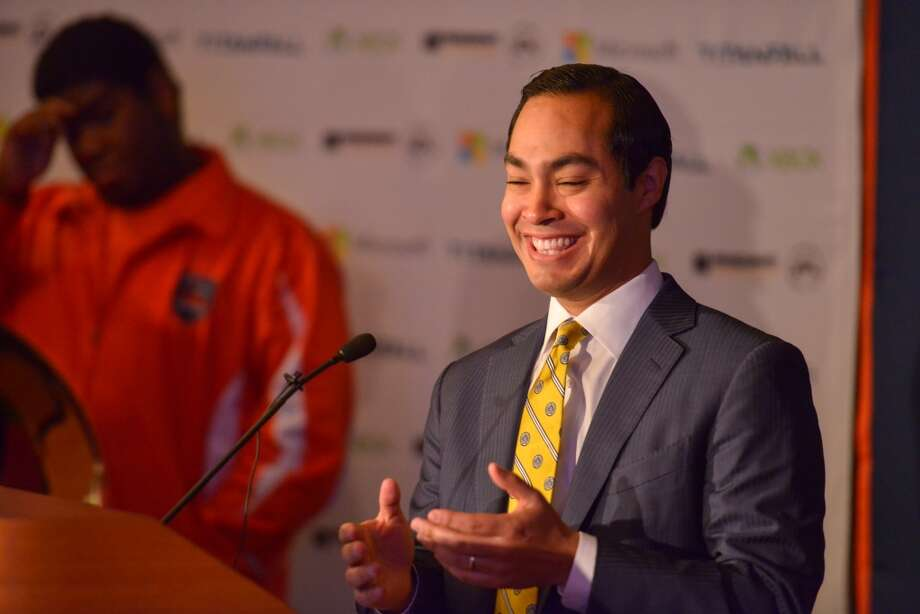 Mayor Julian Castro laughs prior to the announcement of a three-year agreement between Microsoft and UTSA to research and develop sustainable technologies to make data centers more energy efficient and economically viable. The announcement took place at UTSA. Photo: Robin Jerstad, For The Express-News