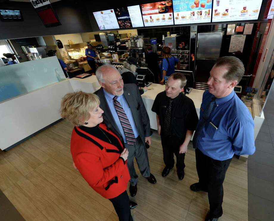 Owners Kathie and John Reeher, left speak with general manager Mike Plante, second from right and Kevin Bernard, director of operations for the latest McDonald's to open today April 18, 2014 in Albany, N.Y.       (Skip Dickstein / Times Union) Photo: Skip Dickstein / 00026555A