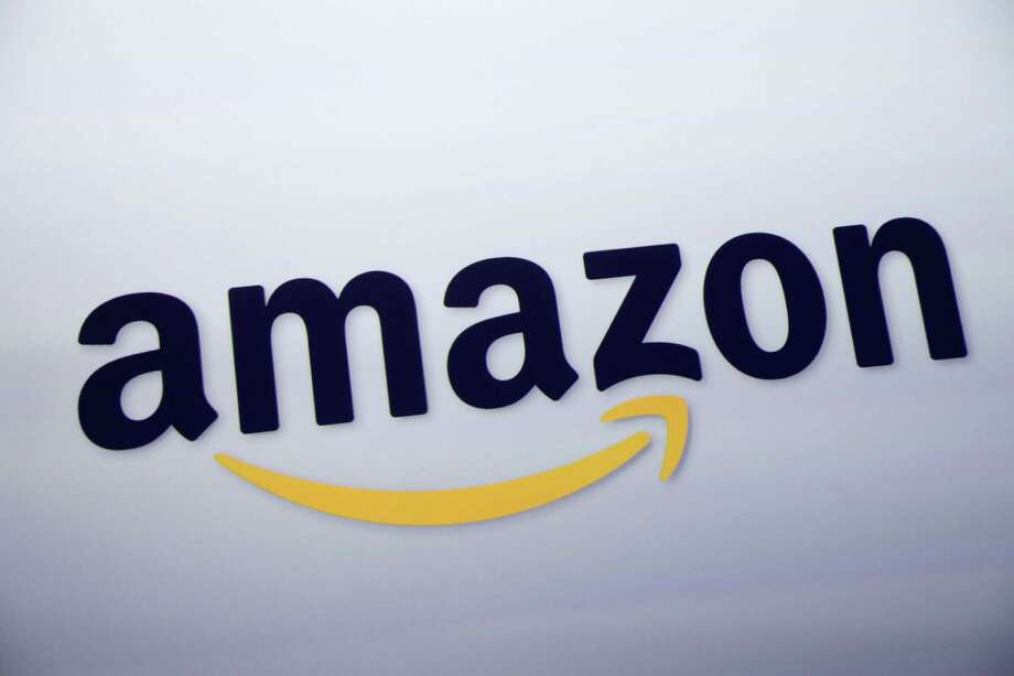 FILE - This Sept. 28, 2011 file photo shows the Amazon logo on display at a news conference in New York. Rumors of an Amazon smartphone reached a fever pitch this week, with several tech blogs speculating that the device could be due out this year. (AP Photo/Mark Lennihan, File) ORG XMIT: NYBZ157 Photo: Mark Lennihan / AP