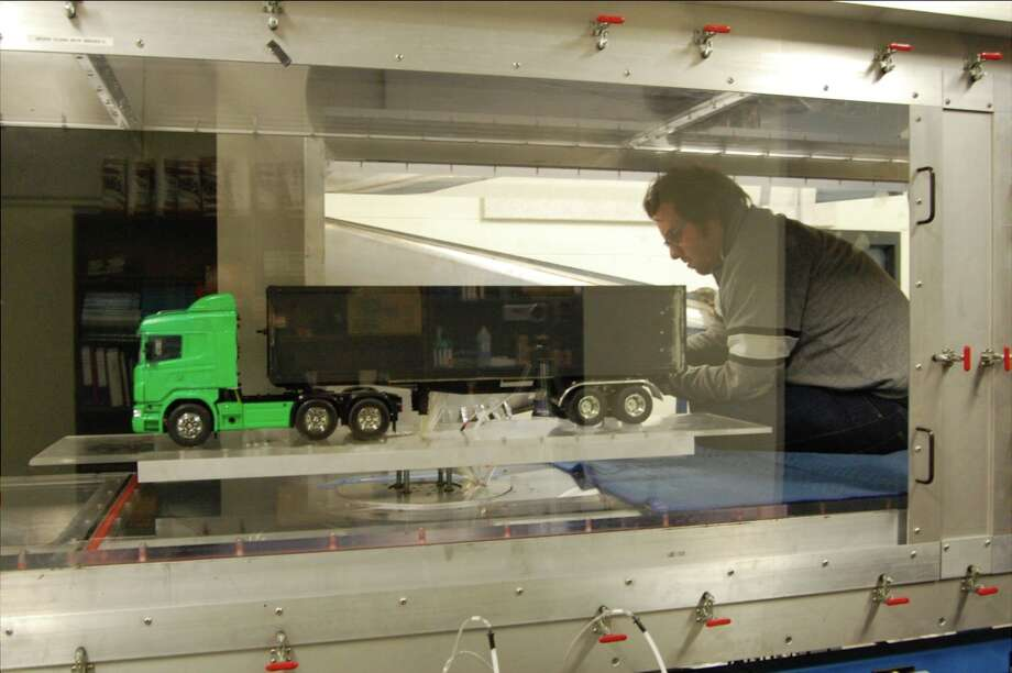 Daniele Gallardo works in a wind tunnel at Rensselaer Polytechnic Institute on how directed air flow actuators can help reduce air resistence and improve energy efficiency in tractor trailers.