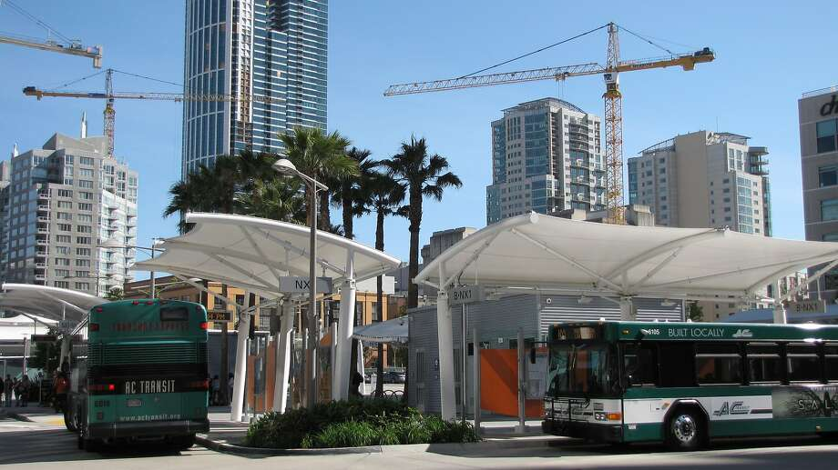 The Transbay Temporary Terminal was built in 2010 at a cost of $18 -- barely a fraction of the budget for the permanent Transbay Transit Center set to open in 2017. Despite this, the open block with its palm trees and umbrella-like canopies functions invitingly well. Photo: John King