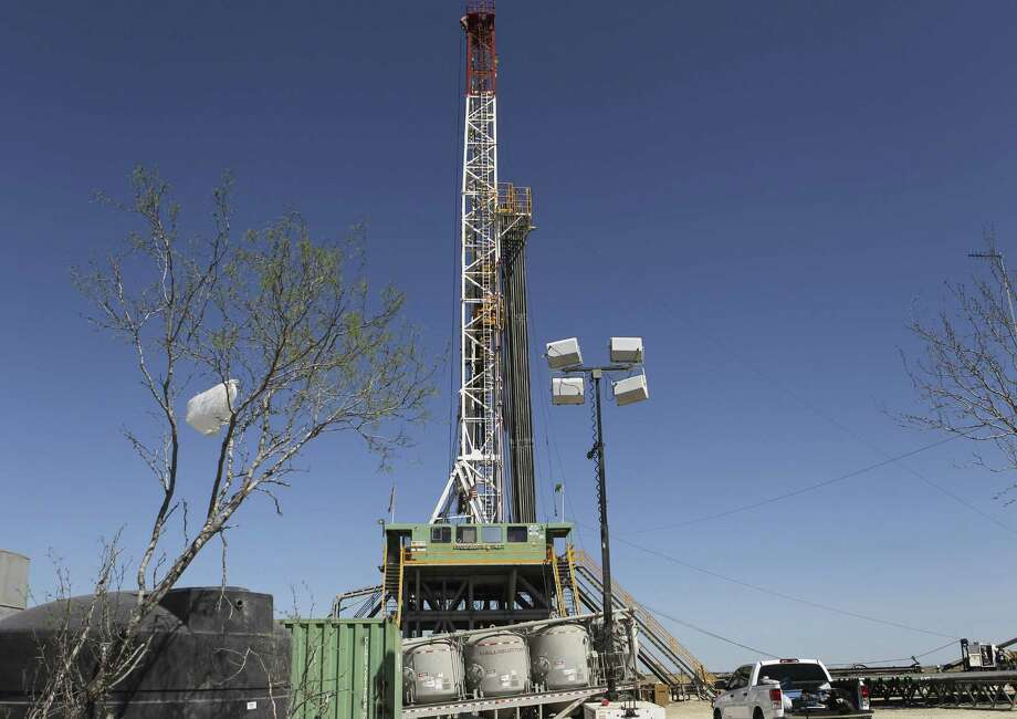 Drilling continues at a rig over the Eagle Ford formation near Cotulla. The Eagle Ford Shale is expected to produce 1.38 million barrels of oil daily in May. Photo: Express-News File Photo / jdavenport@express-news.net