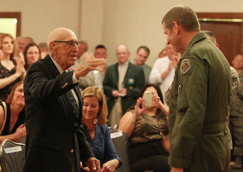 "Retired Air Force Lt. Col. Richard ""Dick"" E. Cole, World War II veteran and one of four surviving Doolittle Raiders, salutes U.S. Air Force's Air Education and Training Command Gen. Robin Rand (right) after a toast ceremony in recognition of 72nd anniversary of the Doolittle Tokyo Raid at JBSA-Randolph on Friday, Apr. 18, 2014. Family members and servicemen were in attendance to honor the Doolittle Raiders including Cole for their historical act in 1942. Photo: Kin Man Hui, San Antonio Express-News / ©2014 San Antonio Express-News"