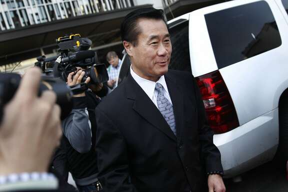 Suspended California state Sen. Leland Yee leaves the Phillip Burton Federal Building and United States Courthouse after his arraignment on Tuesday, April 8, 2014,  in San Francisco, Calif.