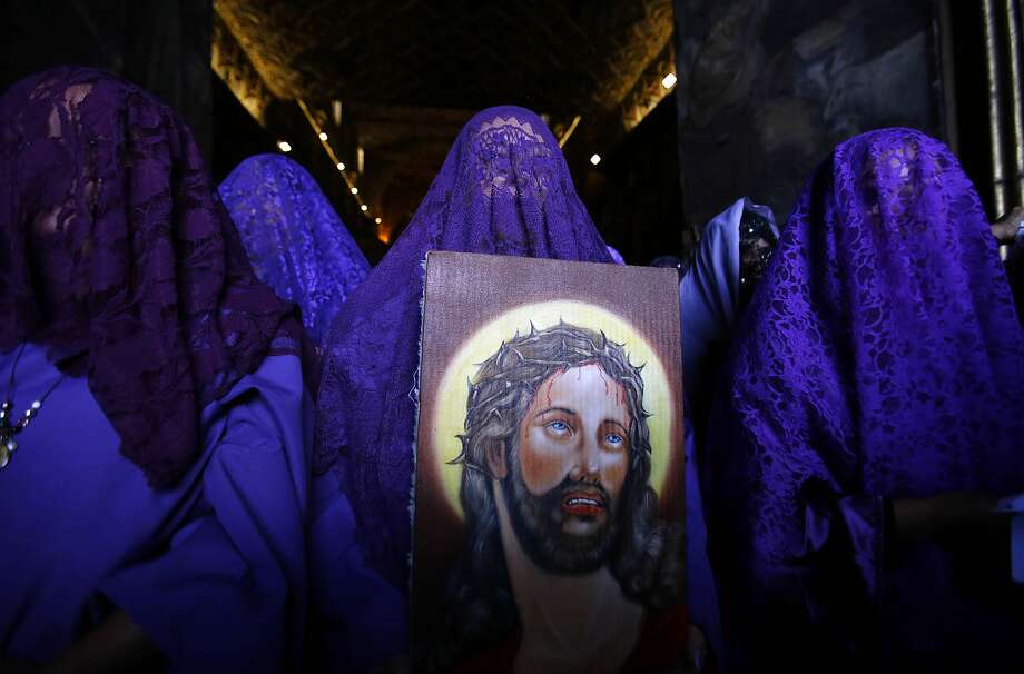 "Female penitents called ""Veronicas"" participate in a Good Friday procession carrying an image of Jesus in Quito, Ecuador, Friday, April 18, 2014. Holy Week commemorates the last week of the earthly life of Jesus Christ, culminating in his crucifixion on Good Friday and his resurrection on Easter Sunday. Photo: Dolores Ochoa, Associated Press"
