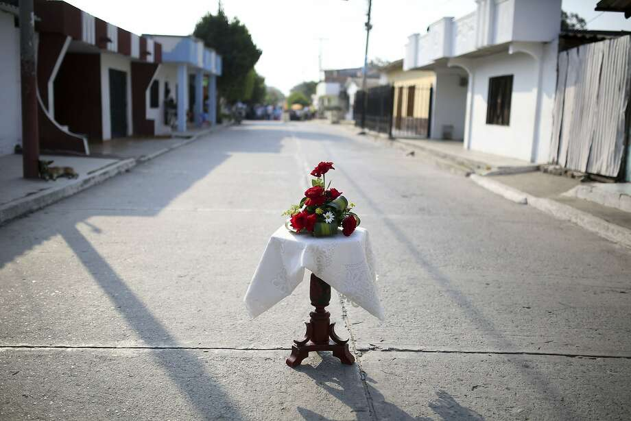 A table with flowers stands on the street as part of Good Friday celebrations in Aracataca, the hometown of late Nobel laureate Gabriel Garcia Marquez in Colombia's Caribbean coast, Friday, April 18, 2014. Since the author died Thursday at the age of 87, residents and holiday makers have been flocking to the home where he was born and raised by his maternal grandparents until the age of 8, paying their final respects to a man who was a symbol of pride for a country long torn by violence. (AP Photo/Ricardo Mazalan) Photo: Ricardo Mazalan, Associated Press