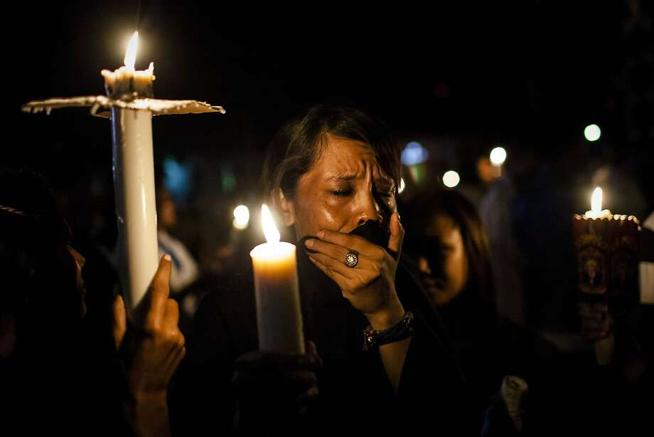 A Catholic worshiper woman cries while accident during the Good Friday procession as their are walking around Larantuka city as part of Holy Week celebrations, known as 'Semana Santa' on April 18, 2014 in Larantuka, East Nusa Tenggara, Indonesia. Easter celebrations in Larantuka started in the 16th century, when Portuguese missionaries entered and acculturated the local people. The ritual appeals to the pilgrims and people from various regions in Indonesia, who come to follow the procession. Holy Week marks the last week of Lent and the beginning of Easter celebrations. Catholics make up approximately three percent of the population of the predominantly Muslim country. Photo: Ulet Ifansasti, Getty Images