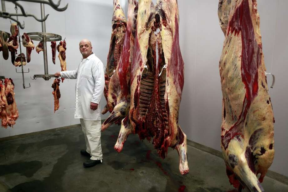 Scotland: Lawrie Malcolmson, 48, poses for a photograph at his work in an abattoir near the town of Lerwick on the Shetland Islands. Photo: CATHAL MCNAUGHTON, Reuters