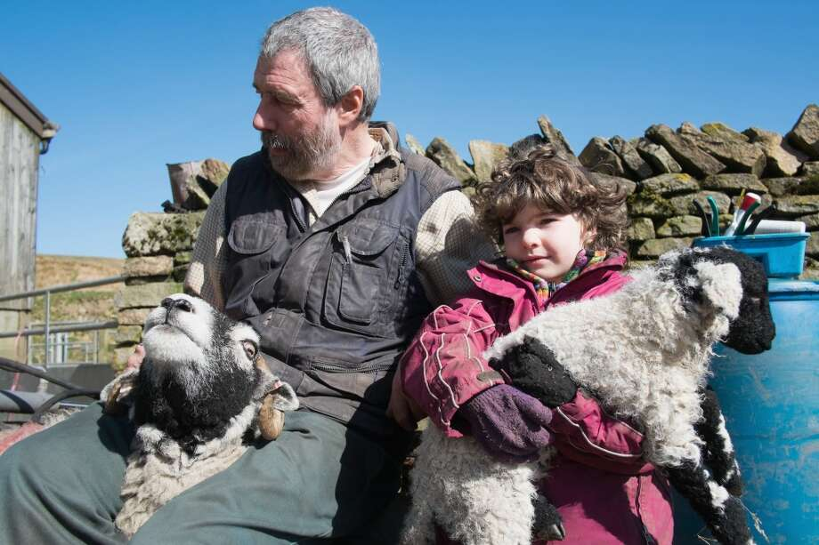 United Kingdom Clive Owen and his daughter Edith, 5, wait to have a sheep and her lamb checked at Ravenseat, the farm of the Yorkshire Shepherdess Amanda Owen, England. Amanda Owen runs a 2,000 acre working hill farm in Swaledale which is one of the remotest areas on the North Yorkshire Moors. Working to the rhythm of the seasons the farm has over 900 Swaledale sheep that are now entering the lambing season as well as cattle and horses. Photo: Ian Forsyth, Getty Images