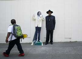 Retired from street performing, Elisha Whittington shows off a life-sized cardboard cutout of himself in from of his home in the Mission on Tuesday April 15, 2014 in San Francisco, Calif.