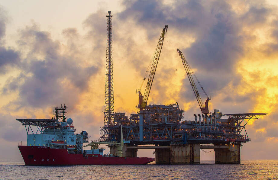 12747655603: A sunrise view of a support vessel in front of the Na Kika oil and natural gas production platform in the Gulf of Mexico, USA. (Photo: BP) / (c)2013 BP PLC