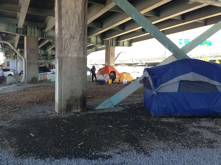 As the weather warms up, homeless camps like this one under the Fifth Street on-ramp are popping up under city freeways. Photo: Andrew Ross/The Chronicle