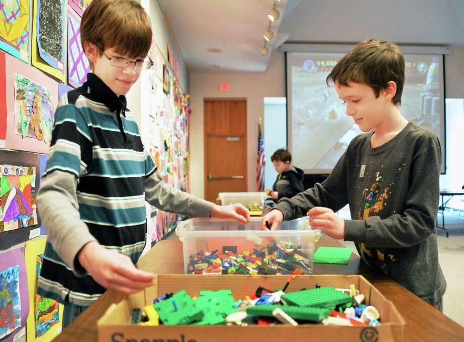"Brothers, Brian Liotta,11, left, and Dylab Liotta, 9, construct a ""flying hut"" during a Lego building for tweens program at the Guilderland Public Library Friday, April 18, 2014, in Schenectady, N.Y.  (John Carl D'Annibale / Times Union) Photo: John Carl D'Annibale / 00026464A"