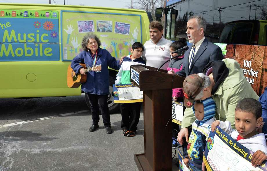 CDTA CEO Carm Basile, at podium, speaks during a news conference announcing a partnership with the Music Mobile to promote bus safety Friday morning, April 18, 2014, in Albany, N.Y. Music Mobile executive director Ruth Pelham is at left. (John Carl D'Annibale / Times Union) Photo: John Carl D'Annibale / 00026546A