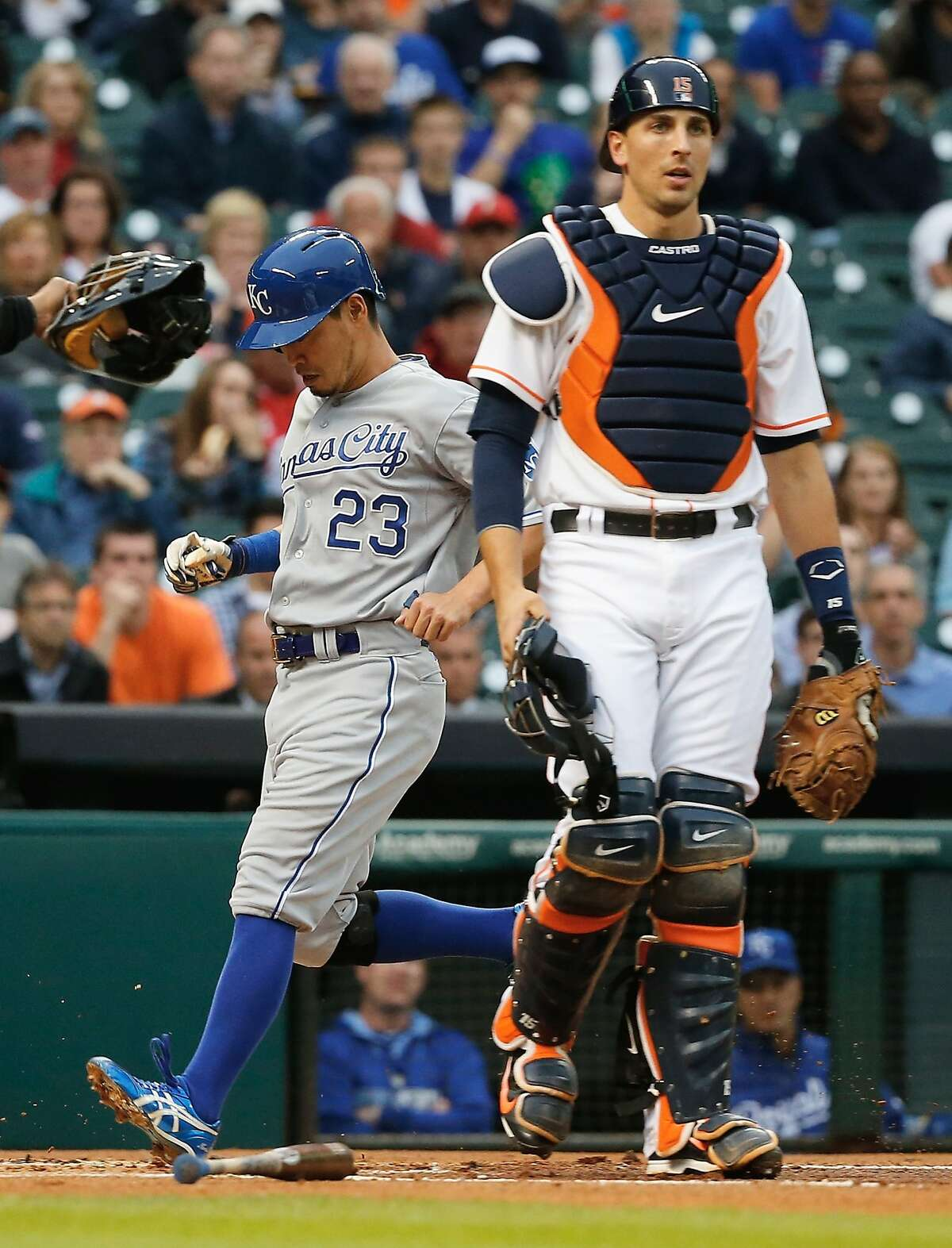 HOUSTON, TX - APRIL 17: Nori Aoki #23 of the Kansas City Royals scores a run in the first inning as Jason Castro #15 of the Houston Astros looks on during their game at Minute Maid Park on April 17, 2014 in Houston, Texas. (Photo by Scott Halleran/Getty Images)