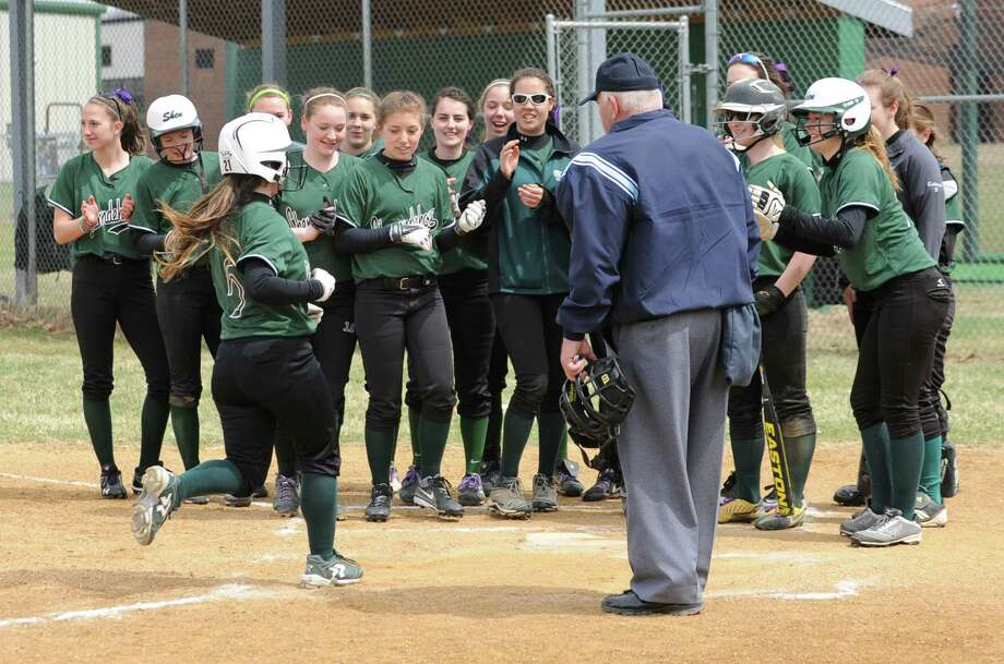 Shenendehowa's Marissa Kirker is greeted by her team at home plate after she hit a home run during a softball game against Colonie Friday, April 18, 2014, at Shenendehowa High School in Clifton Park, N.Y. (Lori Van Buren / Times Union) Photo: Lori Van Buren / 00026550A
