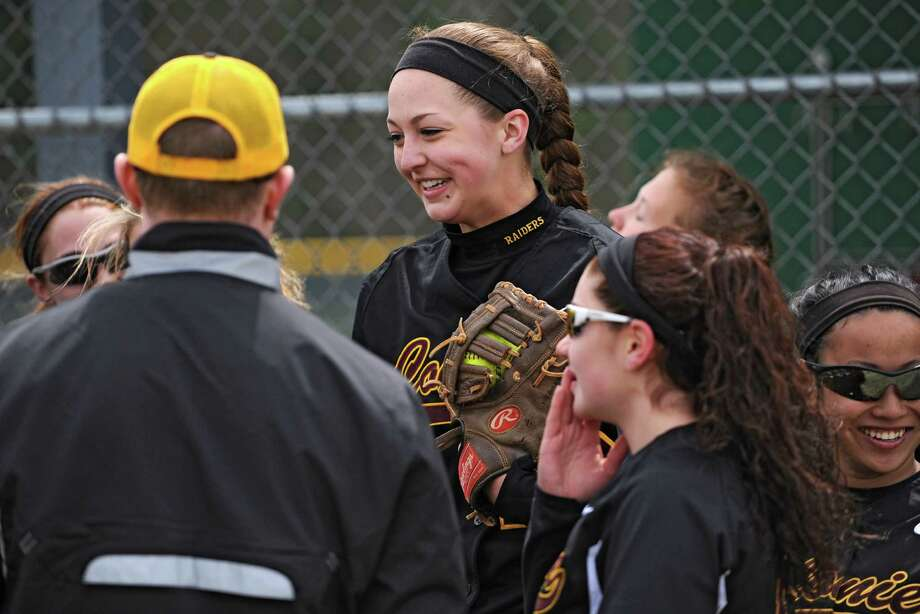 Colonie first baseman Marisa Sholtes, center, joins her team in a huddle before hitting the field in a softball game against Shenendehowa Friday, April 18, 2014, at Shenendehowa High School in Clifton Park, N.Y. (Lori Van Buren / Times Union) Photo: Lori Van Buren / 00026550A