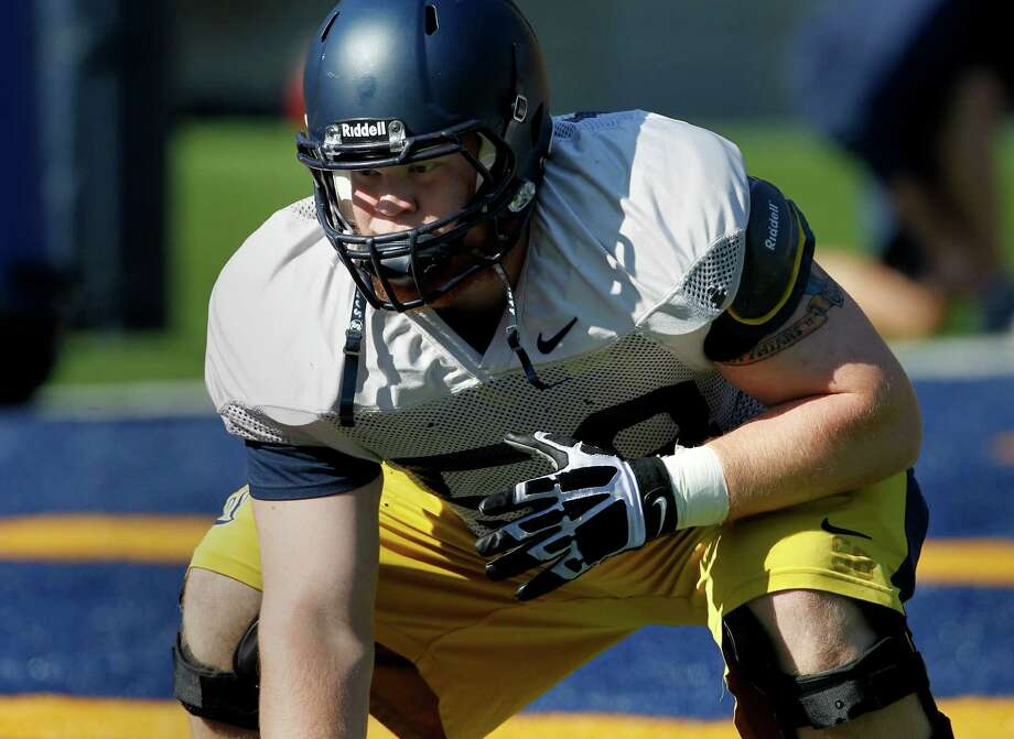 Chris Adcock (58) worked out with the offensive lineman group Thursday August 8, 2013. The Cal football team held a practice at Memorial Stadium for first year head coach Sonny Dykes. Photo: Brant Ward / The Chronicle / ONLINE_YES