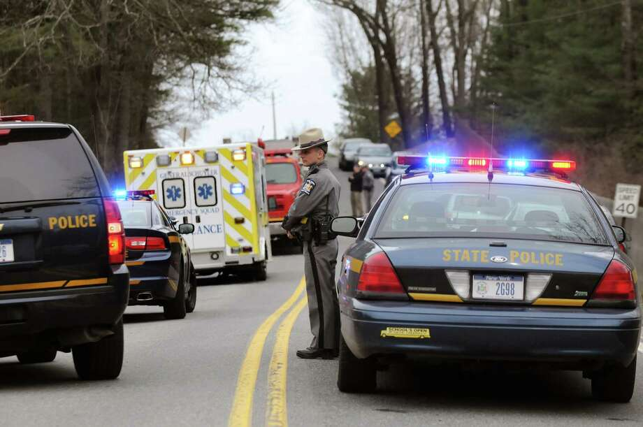 State Police and emergency workers at the scene of a fatal crash on Friday, April 18, 2014, on Burgoyne Road in the Town of Saratoga, N.Y. (Cindy Schultz / Times Union) Photo: Cindy Schultz / 00026562A