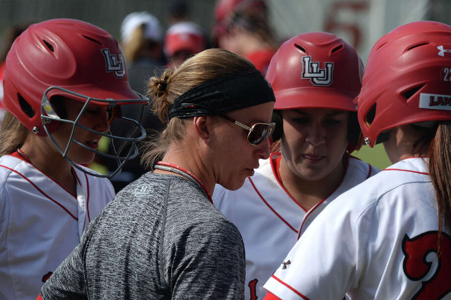 Lamar's Holly Bruder goes over a stadegy with her players against Houston at the lady Card's stadium on Wednesday. Photo taken Wednesday, April 16, 2014 Guiseppe Barranco/@spotnewsshooter Photo: Guiseppe Barranco, Photo Editor