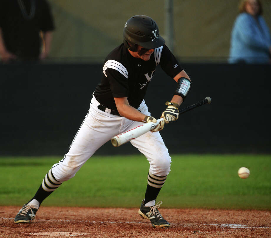 Vidor's Paul Fregia, No. 4, goes for a bunt during Friday's match up against Port Neches-Groves. Vidor played against Port Neches at Vidor on Friday afternoon. Photo taken Friday, 4/18/14 Jake Daniels/@JakeD_in_SETX Photo: Jake Daniels / ©2014 The Beaumont Enterprise/Jake Daniels
