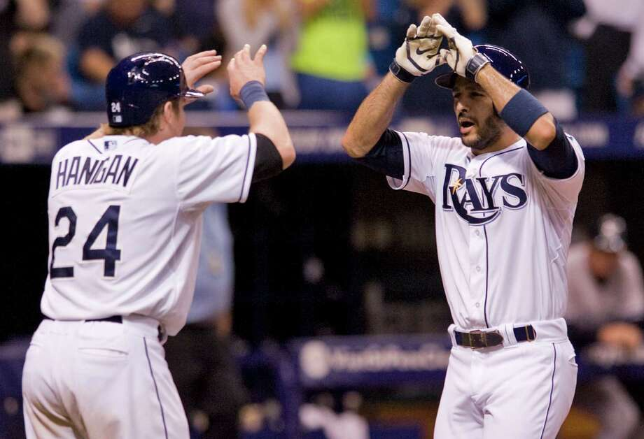 Tampa Bay Rays ' Ryan Hanigan (24) greets Sean Rodriguez at the plate after Rodriguez's two-run homer off New York Yankees reliever Cesar Cabral during the eighth inning of a baseball game Friday, April 18, 2014, in St. Petersburg, Fla. The Rays defeated the Yankees 11-5. (AP Photo/Steve Nesius) ORG XMIT: FLSN118 Photo: STEVE NESIUS / FR69810 AP