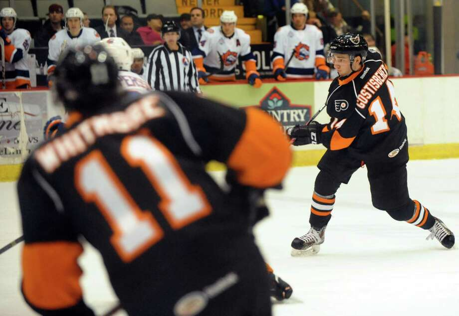 Shayne Gostisbehere, right, makes his professional hockey debut with the Adirondack Phantoms on Friday, April 18, 2014, at the Glens Falls Civic Center in Glens Falls, N.Y. Gostisbehere played his first and only home game with the Phantoms against the Bridgeport Sound Tigers.(Cindy Schultz / Times Union) Photo: Cindy Schultz / 00026512A