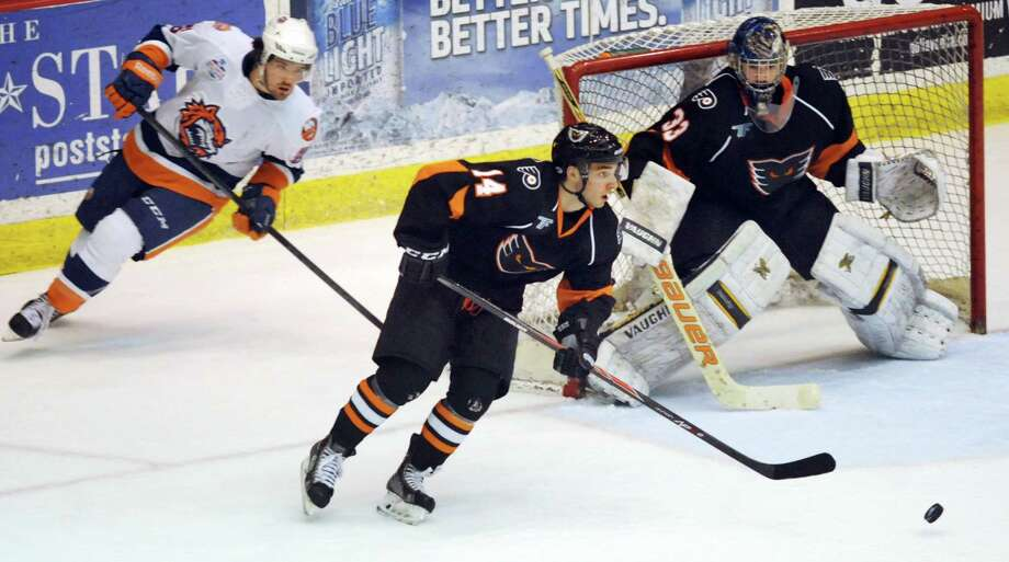 Shayne Gostisbehere, center, makes his professional hockey debut with the Adirondack Phantoms on Friday, April 18, 2014, at the Glens Falls Civic Center in Glens Falls, N.Y. Gostisbehere played his first and only home game with the Phantoms against the Bridgeport Sound Tigers.(Cindy Schultz / Times Union) Photo: Cindy Schultz / 00026512A