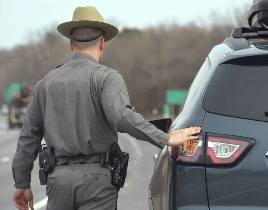 Trooper Emmett Kinzel participates in a week-long enforcement initiative targeting speeding and aggressive drivers across the state Friday afternoon, April 18, 2014, on I-87 in Colonie, N.Y.  The Speed Week campaign runs from April 17 through April 24, 2014. Fines for speeding and aggressive driving can reach nearly $1,000 and add up to 11 points on a driver's license. (Skip Dickstein / Times Union) Photo: Skip Dickstein / 00026558A
