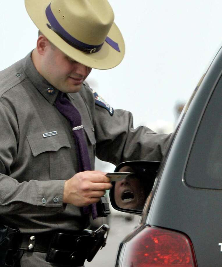 Trooper Emmett Kinzel stops a vehicle for excessive speed as he participates in a week-long enforcement initiative targeting speeding and aggressive drivers across the state Friday afternoon, April 18, 2014, on I-87 in Colonie, N.Y.  The Speed Week campaign runs from April 17 through April 24, 2014. Fines for speeding and aggressive driving can reach nearly $1,000 and add up to 11 points on a driver's license. (Skip Dickstein / Times Union) Photo: Skip Dickstein / 00026558A