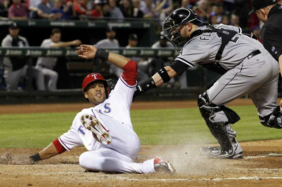 The Rangers' Alex Rios scores ahead of White Sox catcher Tyler Flowers' tag in the third inning. Photo: Richard W. Rodriguez / Fort Worth Star-Telegram / Fort Worth Star-Telegram