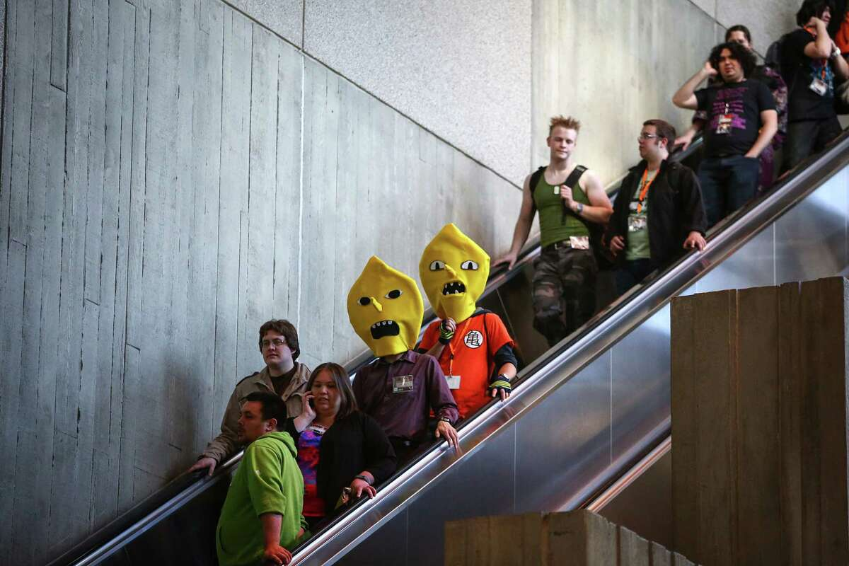 Participants ride an escalator in the Washington State Convention Center during the first day of Sakura-Con on Friday, April 18, 2014. The three day convention features all things anime, with cosplay, cultural panels, dances, concerts, art contests and gaming.