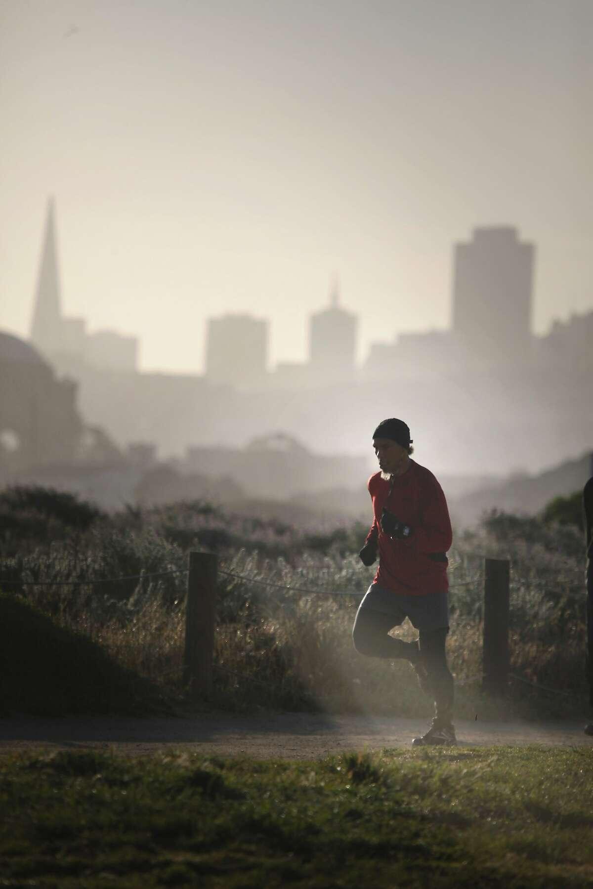 Ronnie Goodman runs at Crissy Field during his morning run on Friday, April 18, 2014, in San Francisco, Calif.